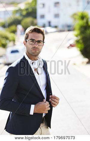 Glasses guy in jacket with headphones portrait