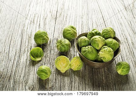 Fresh raw brussels sprouts on a wooden background