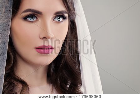 Perfect Fiancee Girl with Make up and White Veil Closeup Fashion Portrait on Background with Copyspace