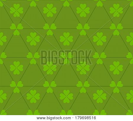 Seamless colored pattern. Print of light green clovers four and three leaves and lines of triangles on green color background.