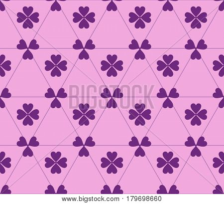 Seamless colored pattern. Print of purple clovers four and three leaves and lines of triangles on pink color background.