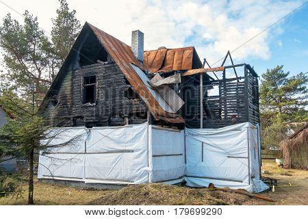 Remains of a burnt out wooden house. Tallinn Estonia EU