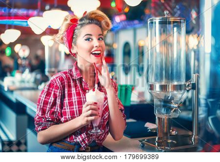 Young pin-up girl with milkshake