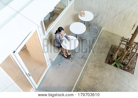 Top view of buisness woman enjoy coffee