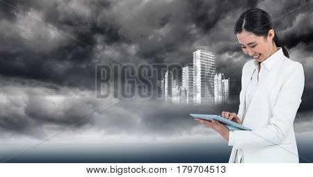 Digital composite of Woman in white coat with tablet and white building graphic against stormy sky