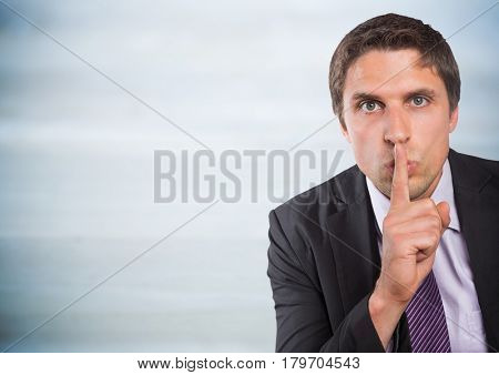 Digital composite of Business man finger over mouth against grey wood panel