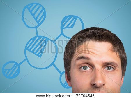 Digital composite of Top of man's head against blue graph and background