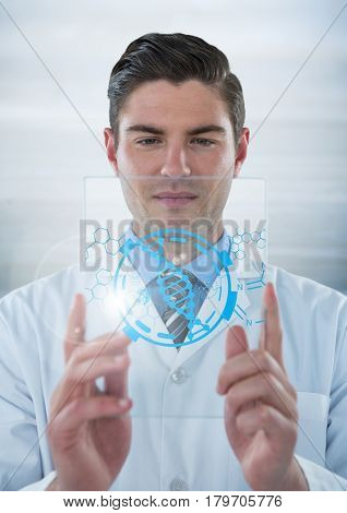 Digital composite of Man in lab coat holding up glass device with blue medical interface and flare against grey backgroun