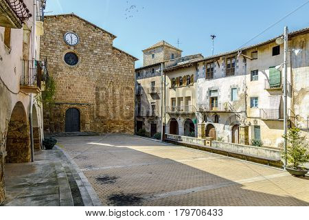 Plaza de la vila in Talarn Catalonia Spain with the Cathedral and City Hall