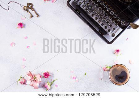 Workspace frame with vintage typewriter, coffee and keys