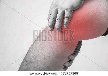 knee injury in humans .knee pain,joint pains people medical, mono tone highlight at knee