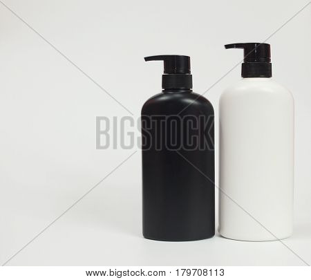 Black and white plastic bottle White background. Flask. Isolated.