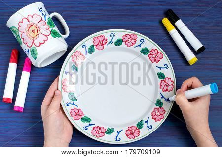 Handmade colorful painting on crockery markers for ceramics. Children's art project craft for children. DIY concept. Step-by-step photo instructions.