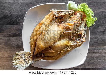 deep fried sea bass with fish sauce and spicy salad