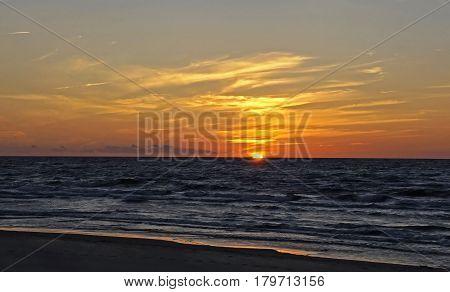 Sunset on the Baltic coast the sun beyond the horizon Jurmala