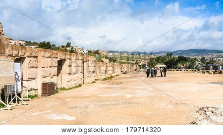 Tourists Near Walls Of Circus Hippodrome In Jerash
