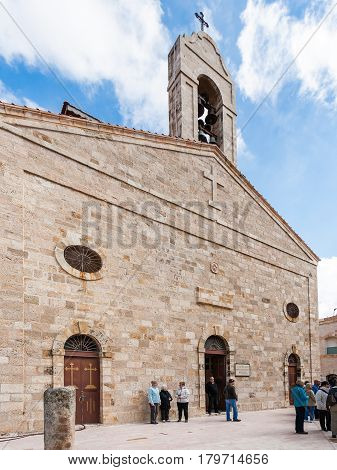 Tourists Near Church In Madaba City In Winter