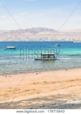 Boats Near Beach Of Aqaba And View Of Eilat City