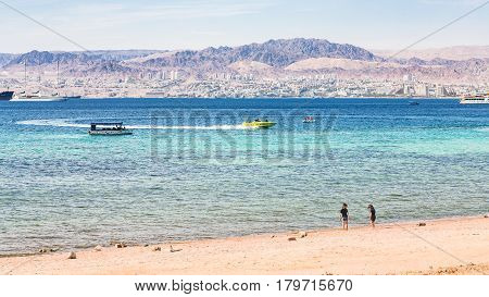 Sand Beach Of Aqaba City And View Of Eilat City