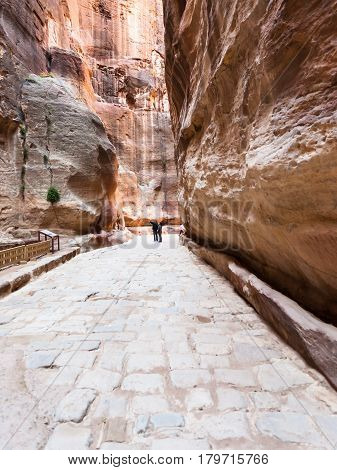 People On Paved Road In Al Siq Gorge To Petra Town