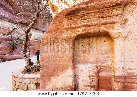 Tourists Near Stone Niches In Al Siq Pass To Petra