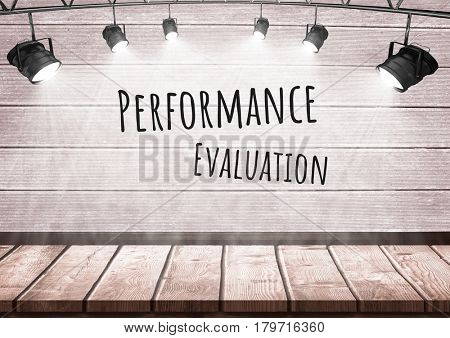 Digital composite of Performance evaluation text with spotlights on wood