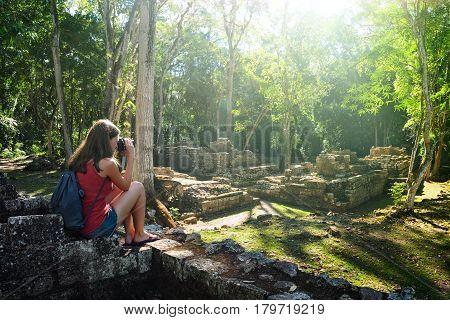 Photographer takes pictures of the ruins of the ancient Mayan city Copan. Central America Hounduras.