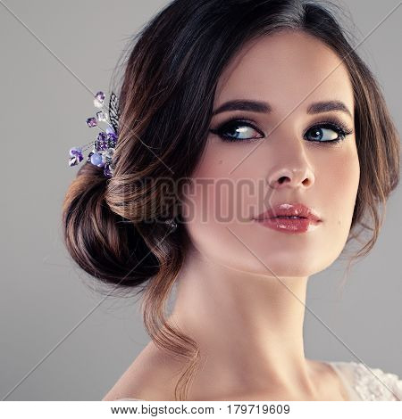 Beautiful Model Woman Fiancee with Bridal Hairstyle Natural Make up and Blue Hairdeco. Face Closeup