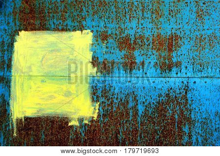 The blue iron wall with a yellow spot