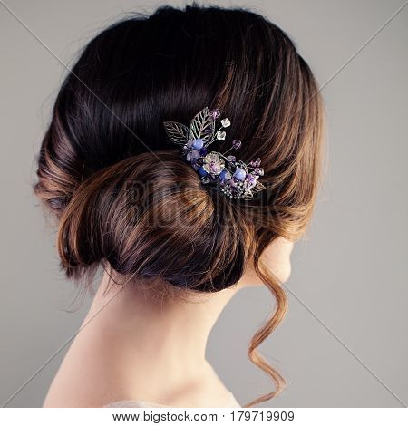 Bridal or Prom Hairstyle. Beautiful Woman with Brown Hair and Hairdeco Back View