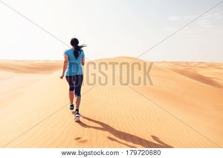 Extreme sports shot - a runner jogging through the desert.
