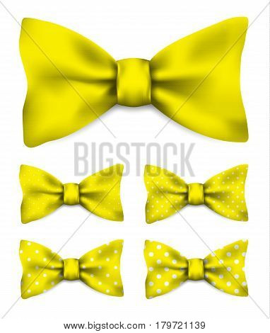 Yellow bow tie with white dots set realistic vector illustration isolated on white background
