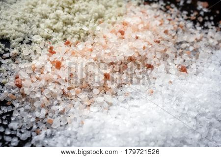 Salt selection as close-up on brown background