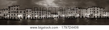 Piazza dell Anfiteatro in Lucca Italy night view panorama