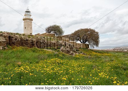 Old lighthouse on the beach of Paphos Cyprus