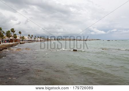 Embankment of the sea of palm trees Paphos city Cyprus
