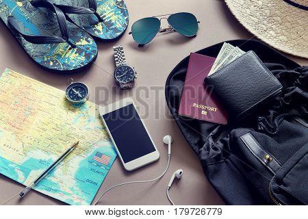Travel items, such as mobile, compass, sunglasses etc..