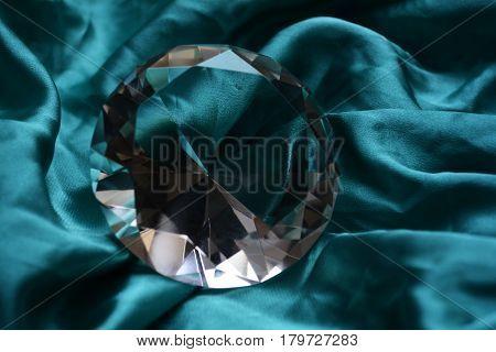 big diamond on an emerald background , a precious stone