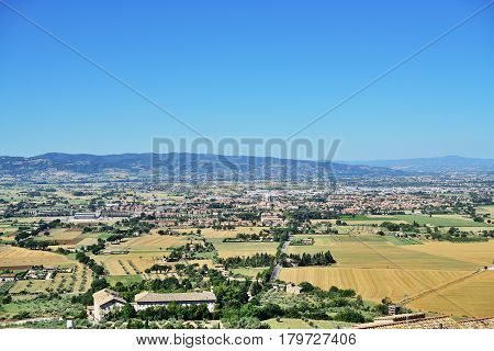 Panoramic view from historic town of Assisi and Basilica of St. Francis. to valley of Tescio and Santa Maria degli Angeli Assisi Umbria Region Perugia Metropolitan Italy.