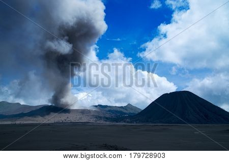 Mount Bromo active volcano with blue sky and white clouds at the Tengger Semeru National Park in East Java Indonesia.