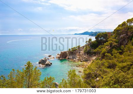 Panoramic picturesque sea landscape of the Lloret de Mar in summer. Beautiful aerial view of the bay of Lloret de Mar in Costa Brava Catalonia Spain. Colorful Horizontal Wallpaper