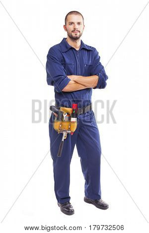Portrait of a young worker standing with arms crossed on white background