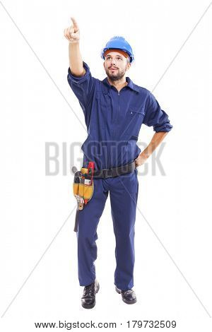 Full lenght of a young worker pointing at copy space, isolated on white background