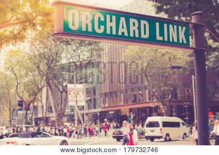 Street Sign Or Traffic Sign Of Orchard Road. The Famous Shopping Main Street Orchard Road Area In Si