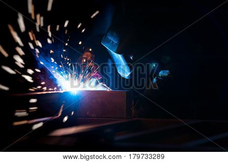 Welding or steel fabrication in construction industry work add the motion filter. Heavy work concept.