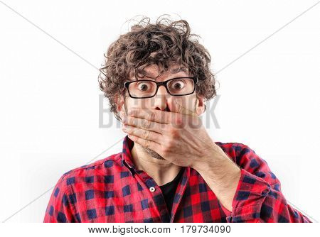 Spellbound guy covering his mouth with his hand