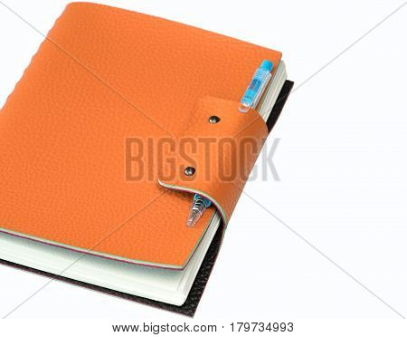 Notebook and ball pen isolated on white background