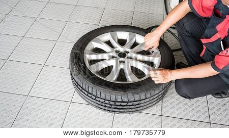 A car mechanic Inflating Tires with Nitrogen