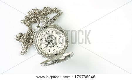Cheap old stainless pocket watch with dragon printed on white background