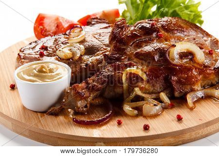 Roast steak on cutting board